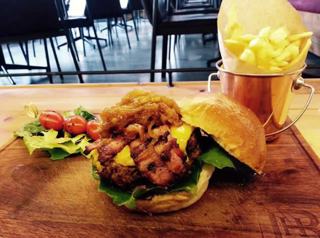 A free-range beef patty with caramelised onions, mature cheddar and bacon at Hinterland Vleishandelaar