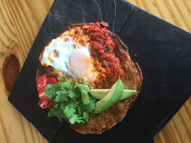 Eggs sunny side up with avo and tomato at Pablo Eggs Go Bar. Photo courtesy of the restaurant.