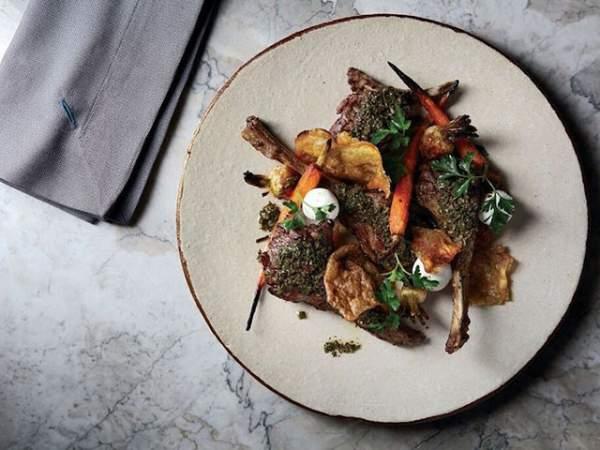Lamb cutlets with chimichurri dish at Marble
