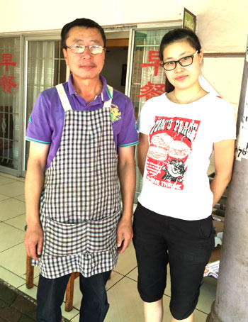 The chef and owner of Chinese Northern Foods with his daughter. Photo courtesy of Hennie Fisher.