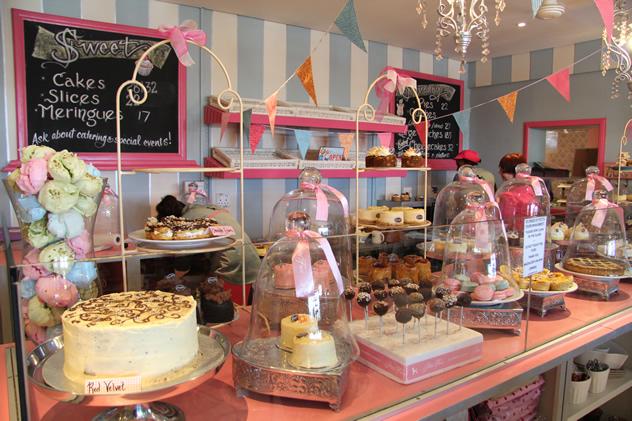 A cake display at Petits Fours Paris