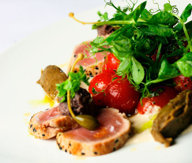 A previous tuna dish, served with roasted tomatoes and eggplant puree. Photo courtesy of the restaurant.