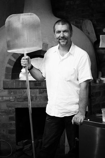 Massimo with his pizza oven. Photo courtesy of the restaurant.