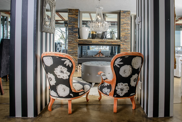 Relaxing chairs and a fireplace at the Orange Restaurant. Photo courtesy of the restaurant.