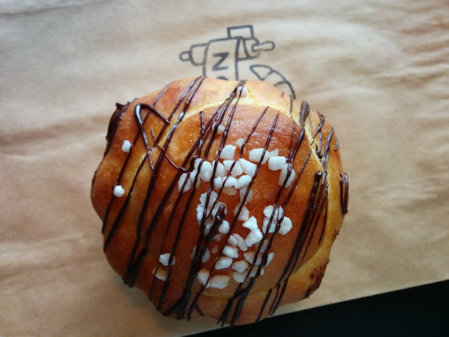 A chocolate drizzled doughnut at Jason Bakery. Photo courtesy of Katharine Jacobs.