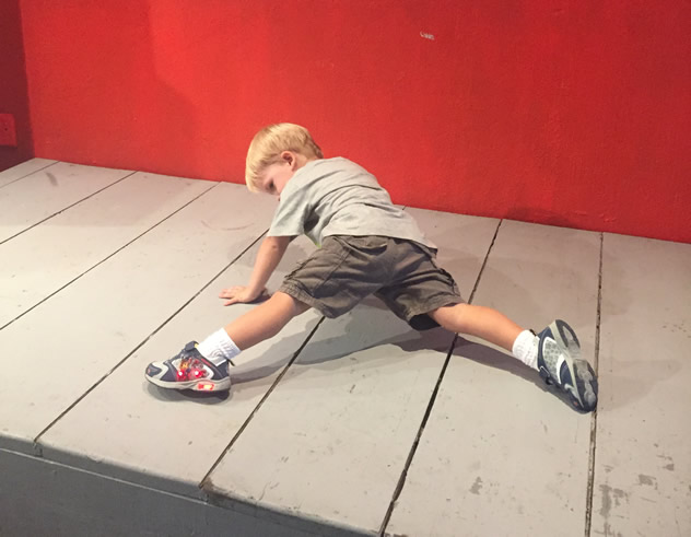 Max breakdancing on a small stage below the TV. Photo courtesy of Ami Kapilevich.