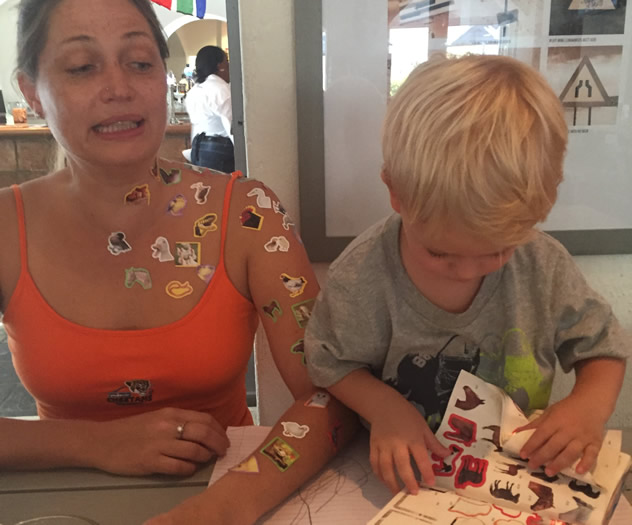 Max sticks his mom full of stickers. Photo courtesy of Ami Kapilevich.