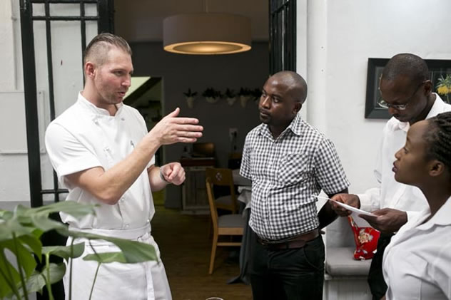 Instruction from a chef to the staff at Restaurant Jardine. Photo courtesy of the restaurant.