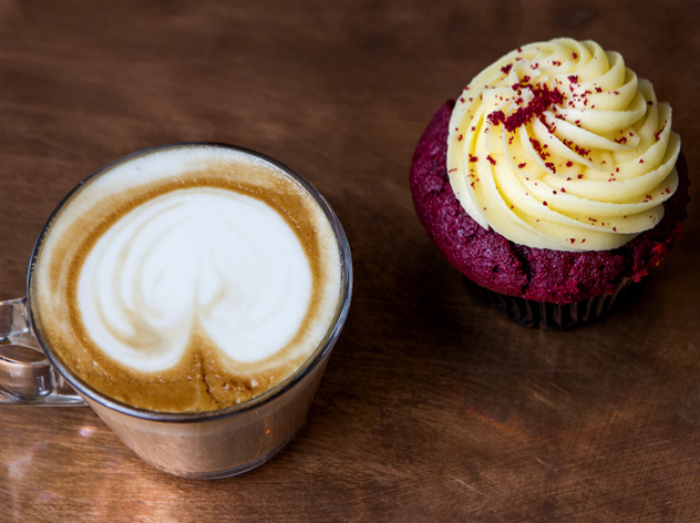 A cappucino and red velvet cupcake at Roast Cafe. Photo supplied.