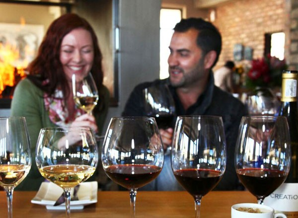 Wine-lovers enjoying a tasting of Creation Wines.