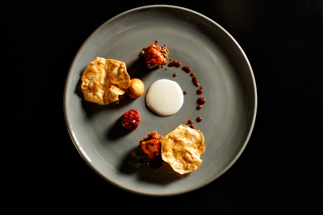 A dish at the The Test Kitchen served on crockery from The Potter's Gallery. Photo courtesy of The Test Kitchen.