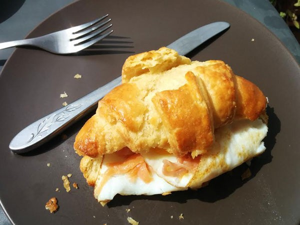 The spelt croissant from Dinkel Bakery, complete with Katharine Jacobs's buttery eggs. Photo by Katharine Jacobs.