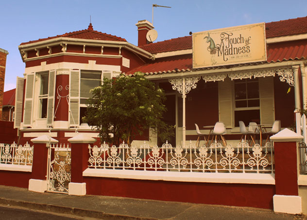 The exterior of A Touch Of Madness. Try grab a table on the veranda. Photo supplied.