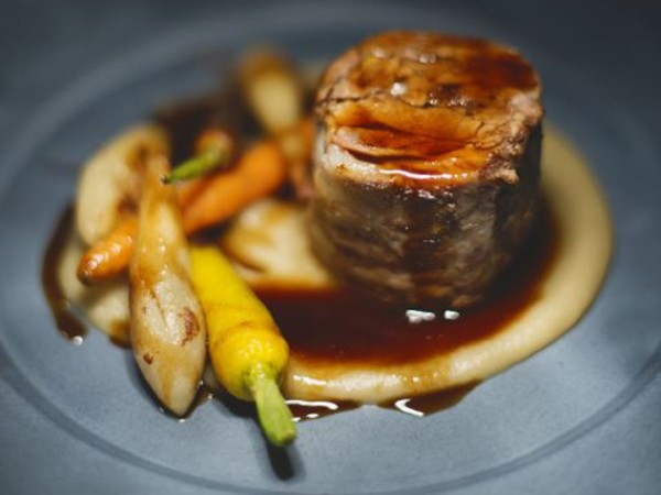 Open Door's braised lamb neck with Jerusalem artichoke. Photo supplied.