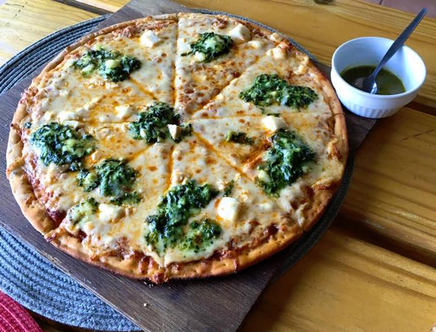 pizza prepared and served at Roasted Coriander