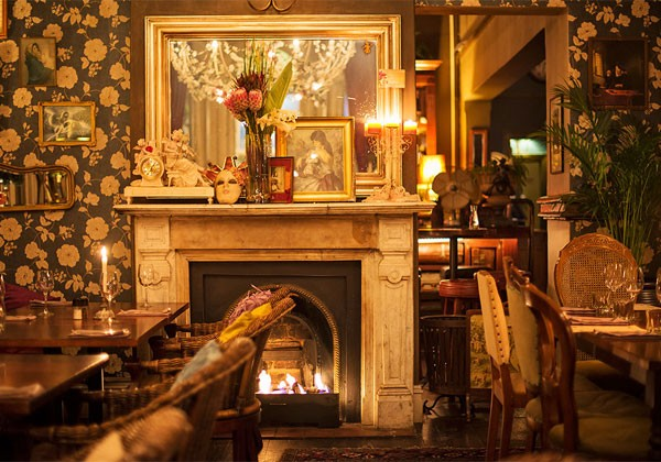 Kloof Street House's warm interior with a roaring fire. Photo supplied.