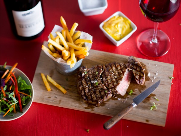 Steak, chips and red wine at Nederburg's The Red Table. Photo supplied.