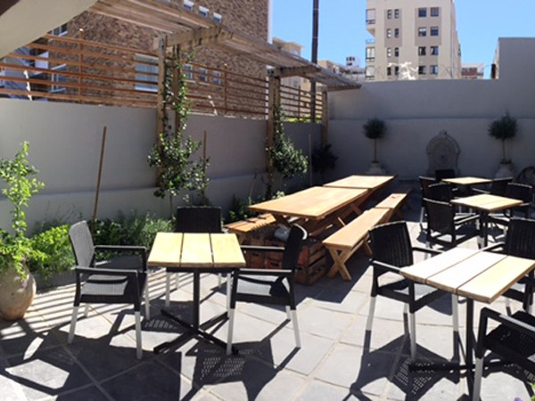 The sunny courtyard at The Press Bar & Grill. Photo supplied.