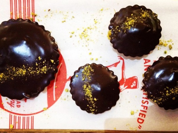 The chocolate ganache tarts sprinkled with pistachio dust at Lucky Bread. Photo supplied.
