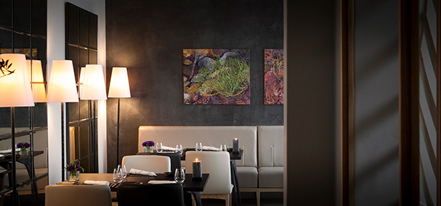 Charcoal walls and furniture in neutral tones create a stylish backdrop for the exceptional food. Photo supplied.