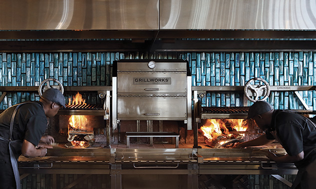 The grill, with its backdrop of Mervyn Gers tiles, is a dramatic centrepiece. Photo supplied.