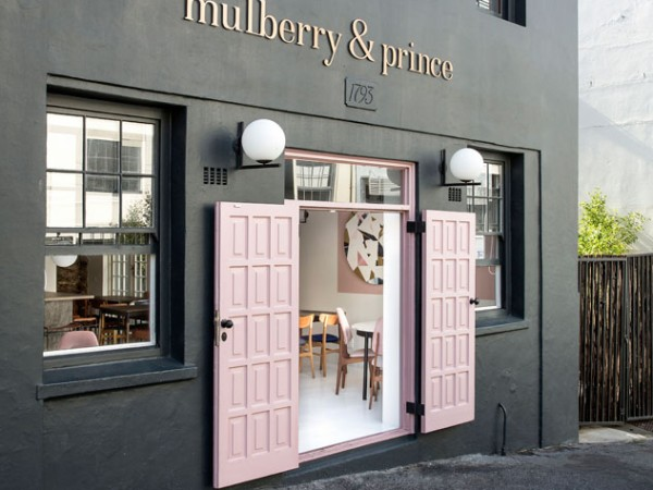 The dusty pink doors that welcome you at Mulberry & Prince. Photo supplied.
