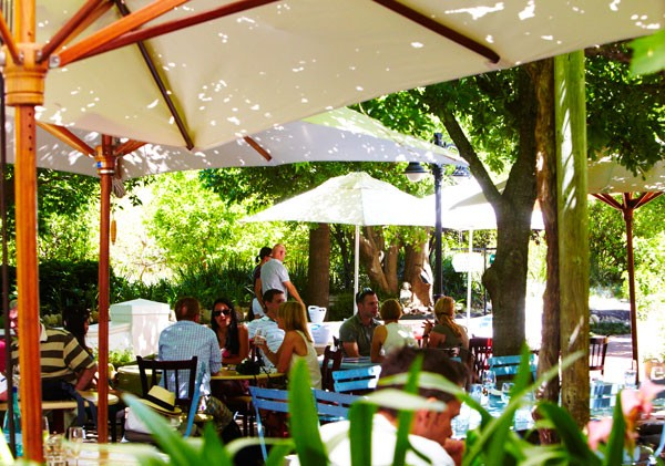 The sunny outdoor dining area at Bread & Wine. Photo supplied.