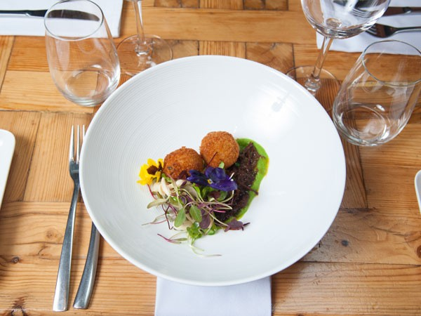 Slow-braised Suffolk lamb shoulder with truffle arancini at Coobs. Photo supplied.