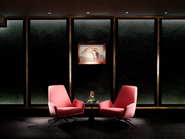 A painting by Pierneef holds court over two bright chairs in the bar. Photo supplied.