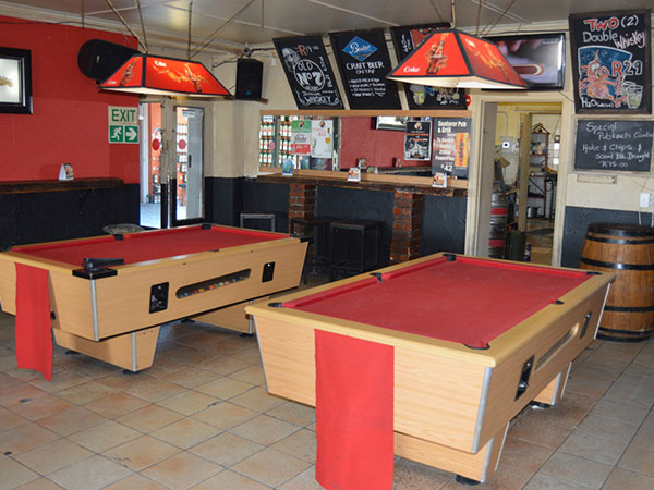 The pub is split into three sections, with pool tables for the competitive. Photo by Greg Landman.