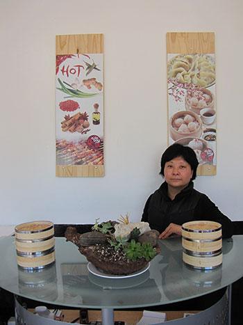 Taste of Mongolia's Jianli Liu left a career as an accountant to open her dumpling shop. Photo by Graham Howe.