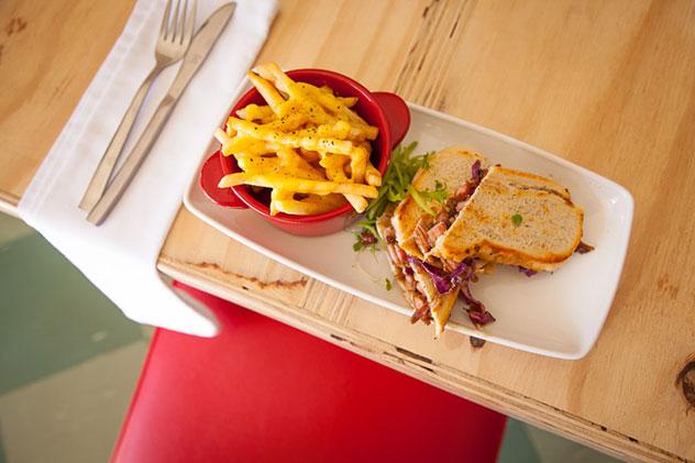 Smoky pork apple slaw sandwich with fries. Photo supplied.