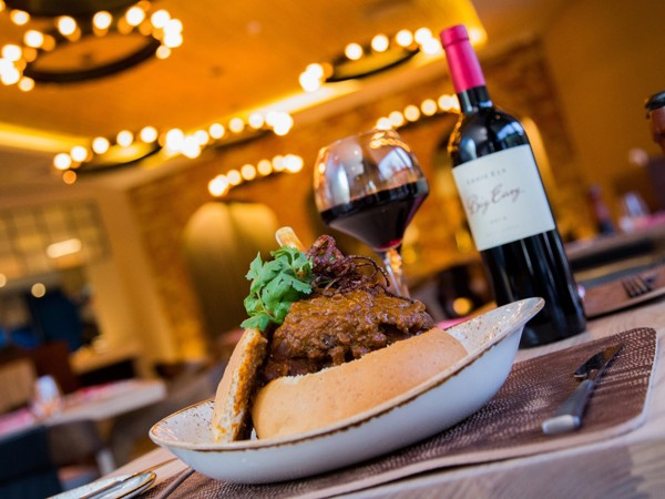 A hearty dish and bottle of red at The Big Easy in Durban. Photo supplied.