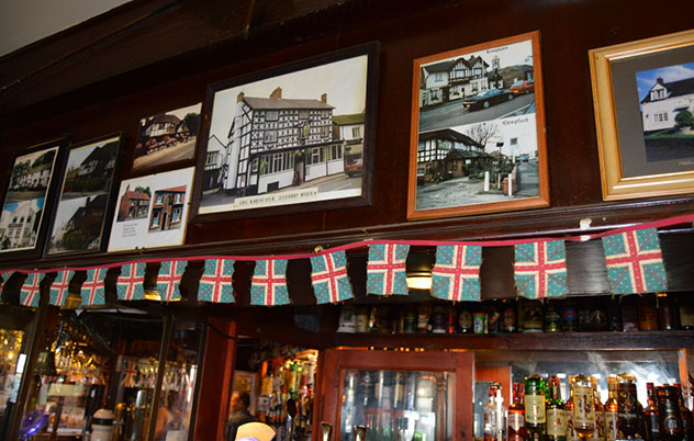 Pictures of other Royal Oak pubs around the world adorn the pub. Photo by Greg Landman.