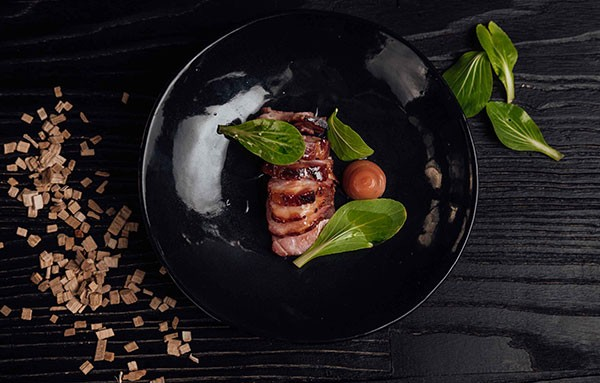 Urbanologi's smoked pork with pak choi. Photo supplied.