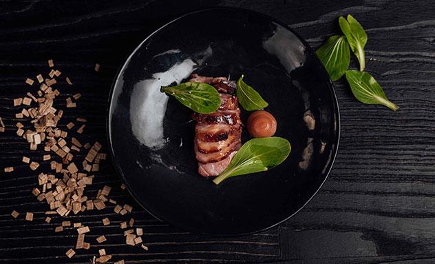Urbanologi's smoked pork with pak choi. Photo supplied.