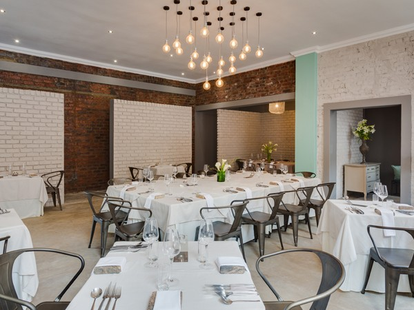 The relaxed yet stylish dining area at Cube Tasting Kitchen. Photo by Quintin Mills Photography.