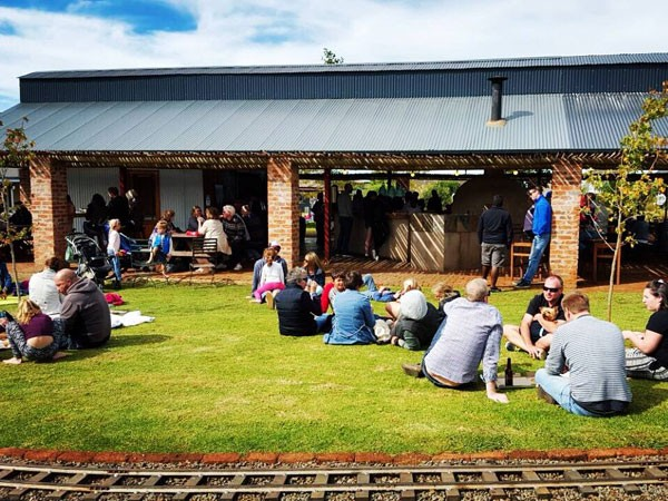 Families enjoying the sunny outdoor area at Piggly Wiggly. Photo supplied.