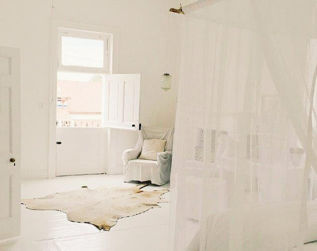Inside one of the guesthouse's beautiful white rooms. Photo supplied.