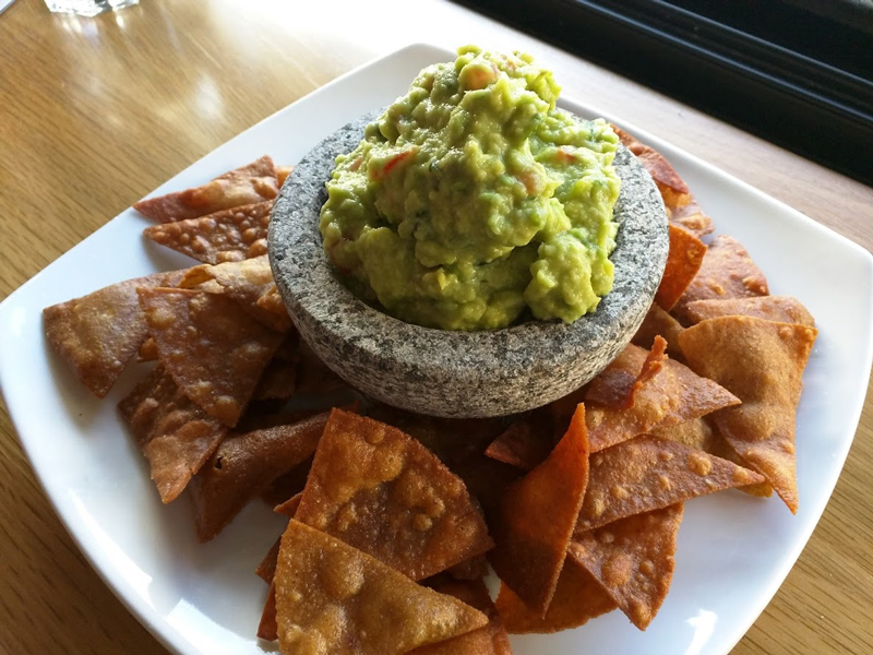 nachos and guacamole prepared and served at Fuego