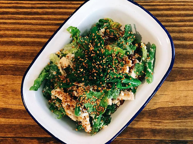 Baby gem salad with green beans, asparagus, tenderstem broccoli, toasted sesame pecans and lemon labneh dressing. Photo supplied.