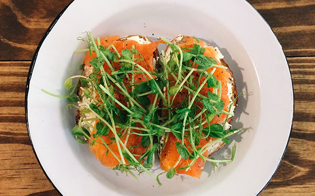 A tartine with cream cheese, smoked trout and pea shoots. Photo supplied.