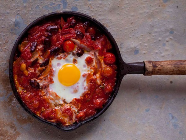 Baked kidney beans with tomato-chilli and eggs. Photo supplied.