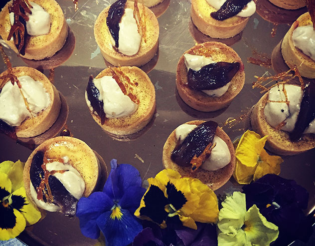 Milk tart with Castle Milk Stout-poached pears and caramel shards. Photo supplied.