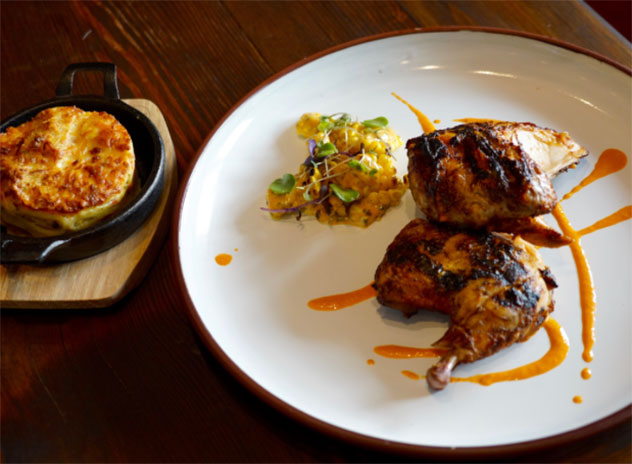 There's also free-range peri-peri chicken, served with a corn salad and Bahamian mac and cheese. Photo supplied.