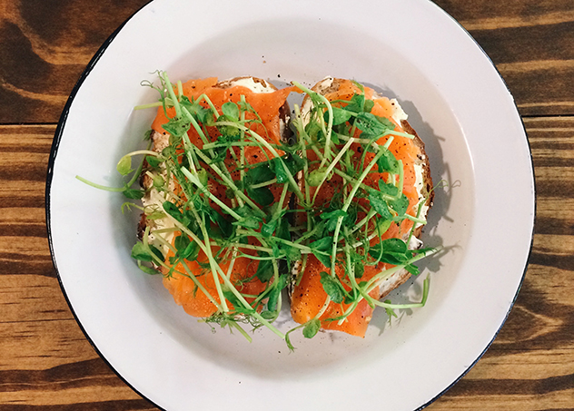 Tartine topped with smoked salmon trout and cream cheese