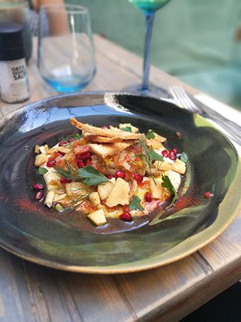 The aubergine starter with tahini, pomegranate arils and pita shards.