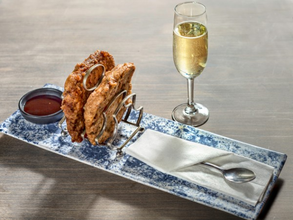 The prawn toast with bubbly at Mink & Trout. Photo courtesy of the restaurant.