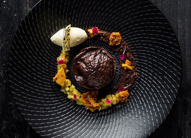 The 'Not for Pussies' chocolate fondant with lime, honeycomb, caramelised pineapple chilli salsa and yuzu sorbet. Photo by Michael le Grange.