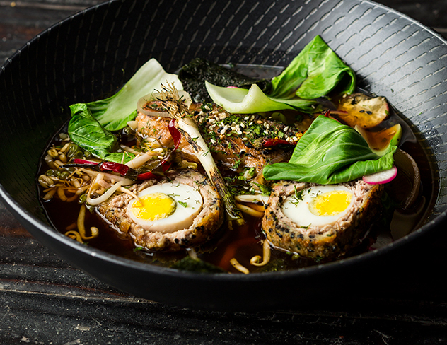 Rock 'n Ramen pork belly ramen with a soft boiled scotch egg, udon noodles, spring onion, toasted sesame, Chinese leaf, and bean sprouts in a lemongrass broth. Photo by Michael le Grange.